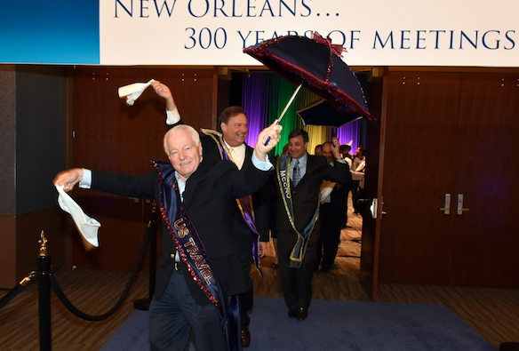 U.S. Travel Association President and CEO Roger Dow participating in a 'second line' at the New Orleans Morial Convention Center.