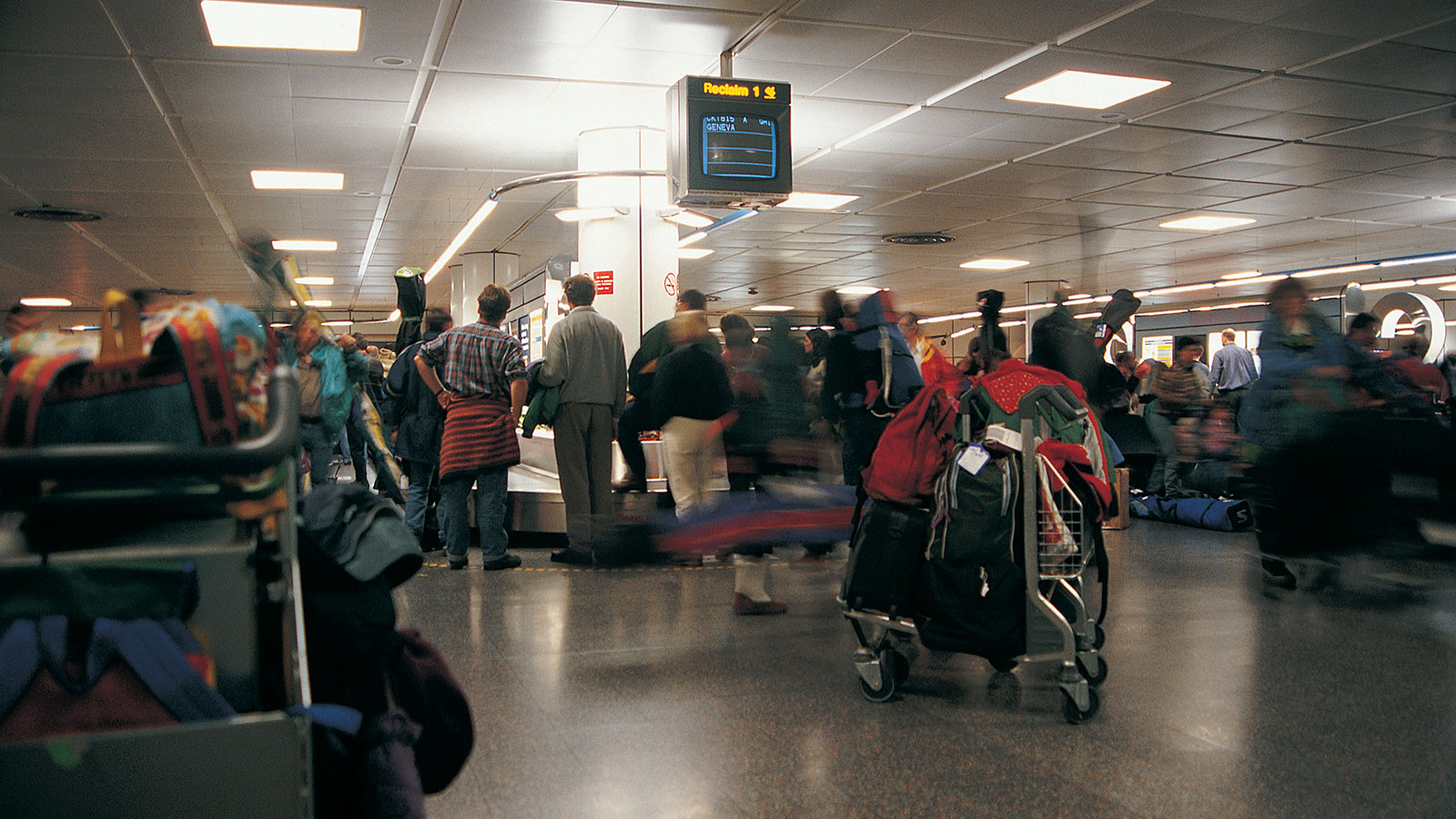 Image of travelers in line at an airport