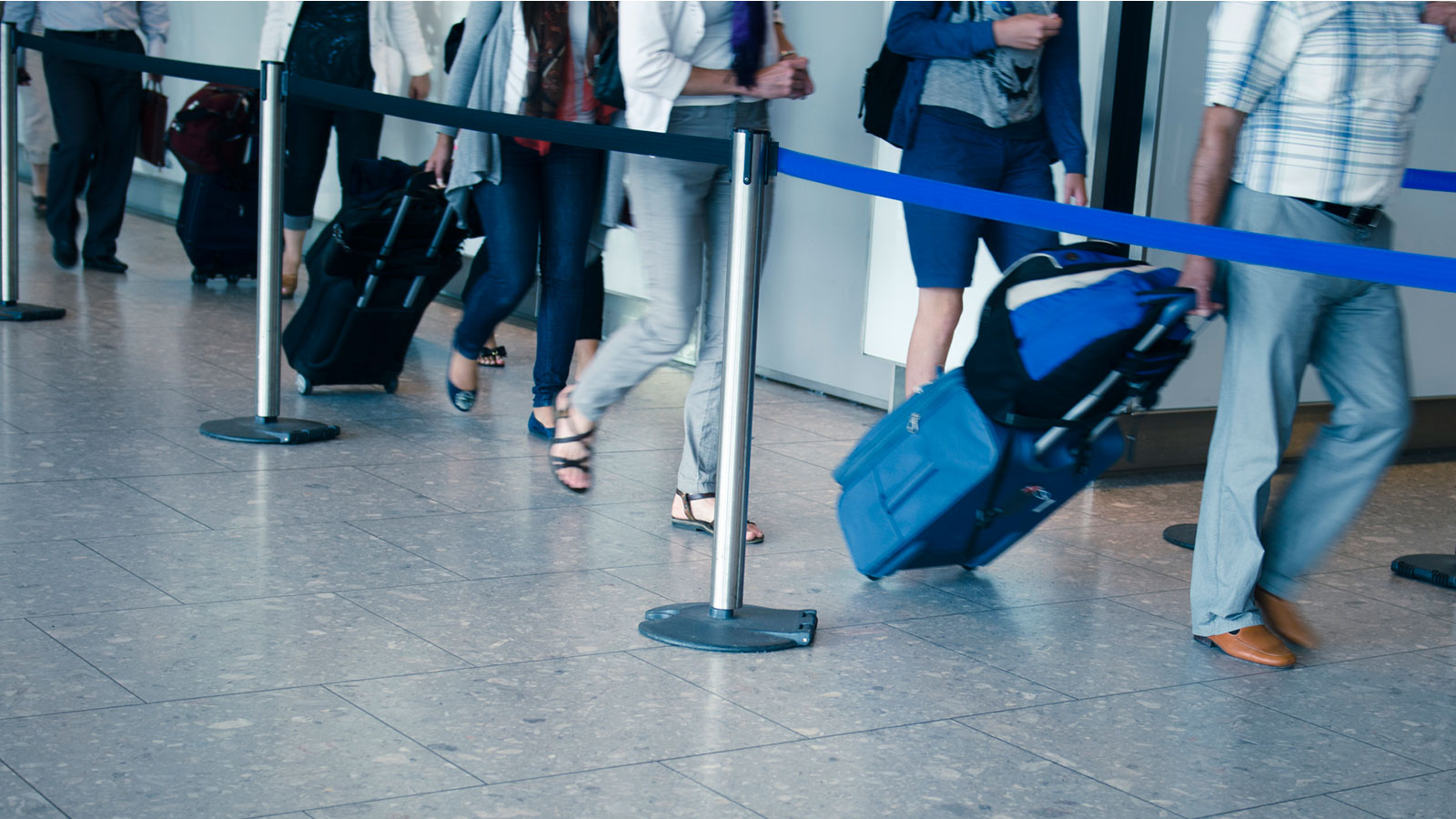 Travelers in line with suitcases