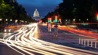 traffic on a road at night in front of the Capitol in DC