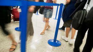 media TSA airport security line summer flip flops