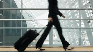 media woman-walking-airport.png